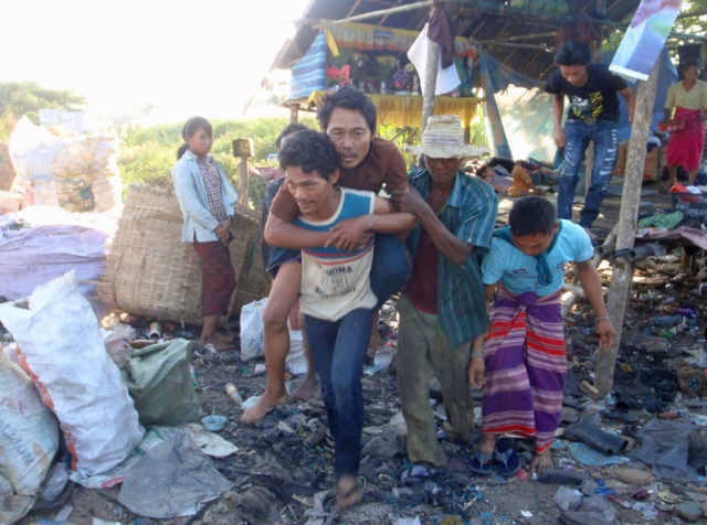 The man's family carrying him to the truck
