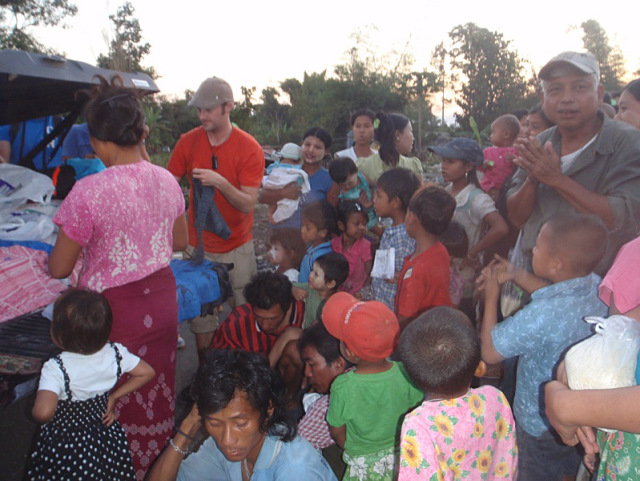 Families receiving rice, clothing and boots.