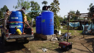 Working on the new clean water delivery system, now a fraction of the cost
