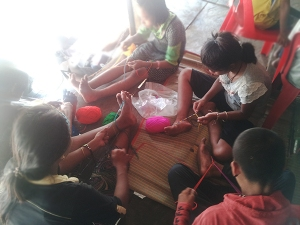 Friendship bracelet making among students