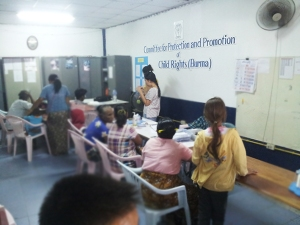 Families at Mae Tao Clinic in the CPPR offices working on birth registration paperwork